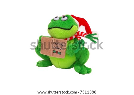 Stuffed frog wearing a santa hat and scarf holding a christmas carol book