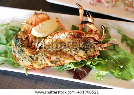 stuffed lobster baked with cheese and yuzu miso sauce - stock photo