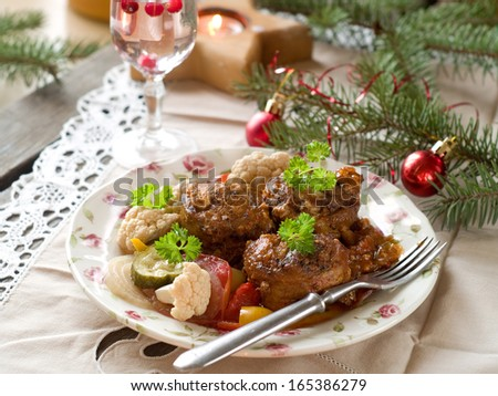 Stuffed meat roll with roasted vegetable, selective focus - stock photo