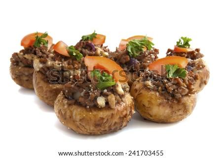 Stuffed mushrooms close up isolated over white - stock photo