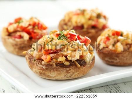 Stuffed mushrooms on plate - stock photo