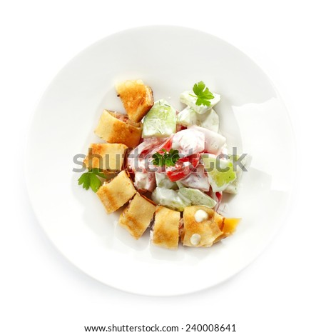 stuffed pancake and vegetable salad, food for children isolated on white - stock photo