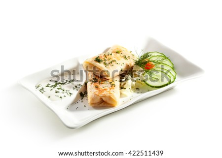 Stuffed Pancakes Garnished with Cucumbers - stock photo