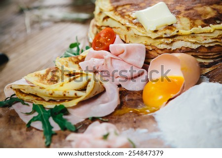 stuffed pancakes with ham cheese and vegetables - stock photo