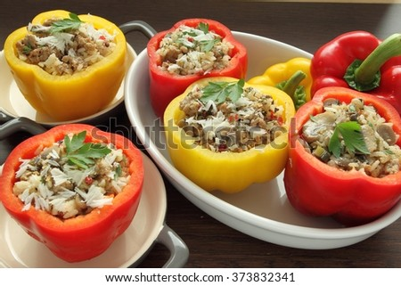 Stuffed paprika with meat, rice and vegetables. - stock photo