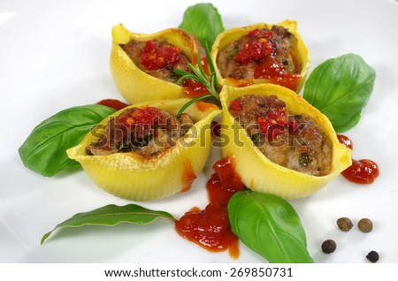 stuffed pasta shells with rosemary and basil - stock photo