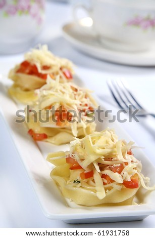 stuffed pasta with paprika and cheese - stock photo