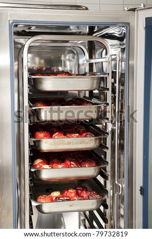 stuffed peppers in an industrial convection oven