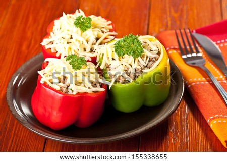 Stuffed peppers roasted with cheese - stock photo