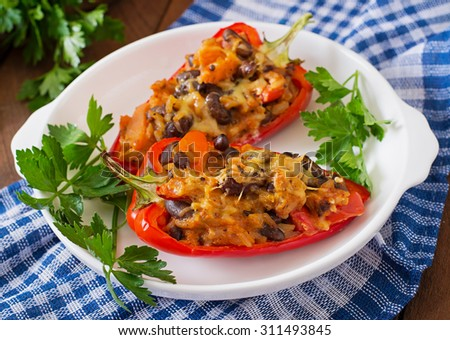 Stuffed peppers with rice, beans and pumpkin in the Mexican style - stock photo