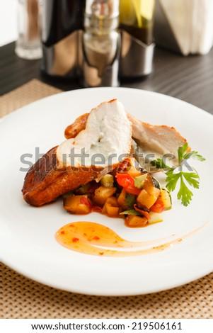 stuffed pork tenderloin roulade garnished with vegetables - stock photo