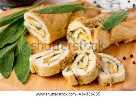 Stuffed roll of chicken breast with cheese and sage selective focus - stock photo