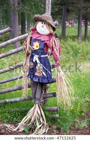 Stuffed scarecrow on a traditional fence in northern Sweden