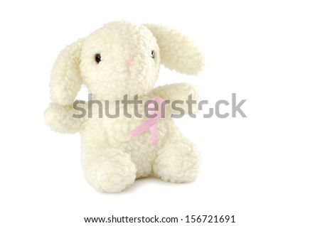 stuffed sheep with pink breast cancer awareness ribbon - stock photo