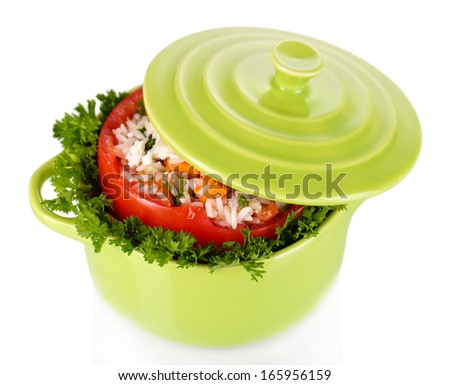 Stuffed tomato in pan isolated on white