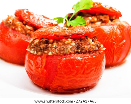 Stuffed tomato with meat and rice isolated on white background