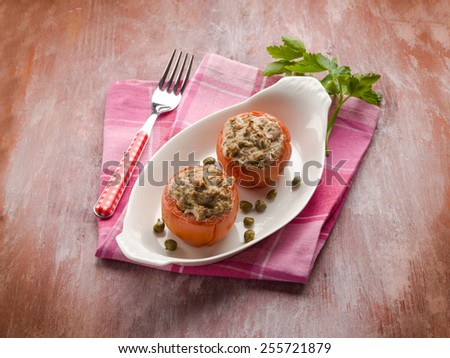 stuffed tomatoes with tuna and capers - stock photo