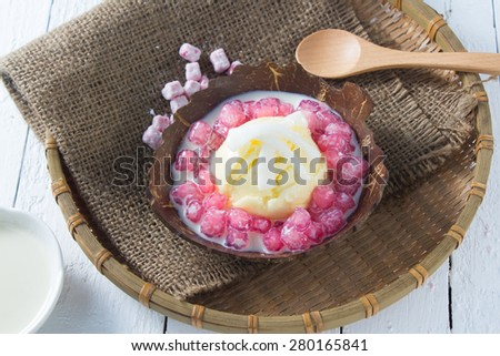 Stuffed Water Chestnut in Syrup and Coconut Milk served with icecream, Thai Cuisine - stock photo