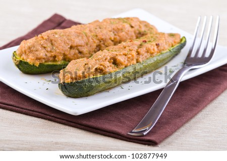 Stuffed zucchini halves. - stock photo