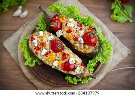 Stuffing: eggplants stuffed with rice and vegetables - stock photo