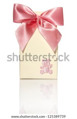 Stuido shot of small gilf box with pink ribbon. - stock photo