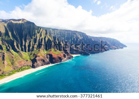 stunning aerial view of na pali coast at kauai island, hawaii from helicopter - stock photo