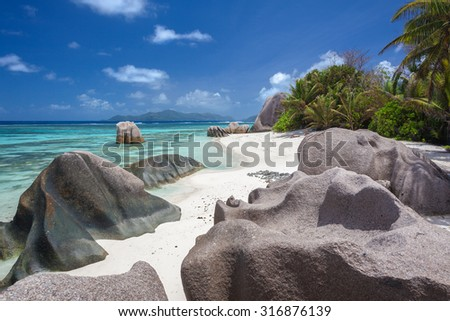 Stunning Beach With Turquoise Sea And Granite Boulders On White Sand