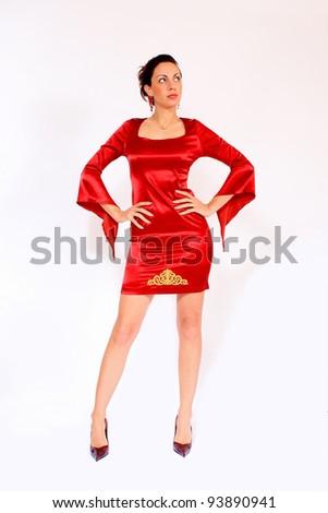 Stunning beautiful brunette wearing elegant evening dress on white background - stock photo