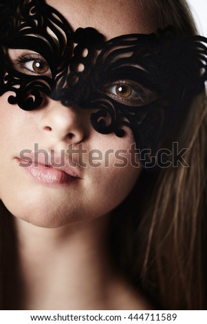 Stunning beauty in masquerade mask, portrait - stock photo