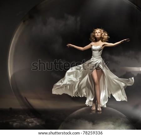 Stunning blonde wearing gorgeous dress - stock photo
