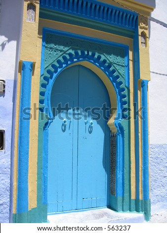 Stunning blue door in a village of Chefchaouen - stock photo