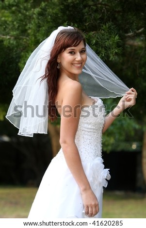 Stunning bride with lovely smile in a beautiful wedding dress