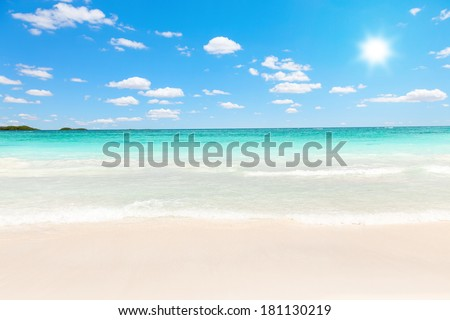 Stunning Caribbean beach of transparent water against the sun - stock photo