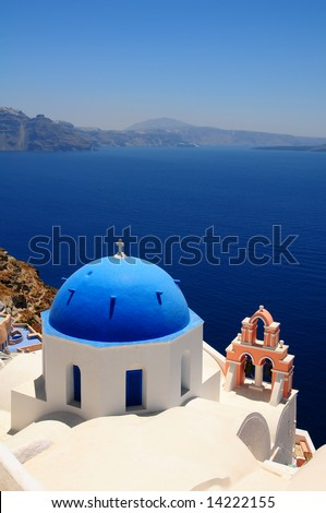 Stunning cupolas with the Caldera (volcano) in the distance in the Greek island of Santorini - stock photo