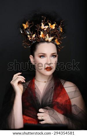 Stunning Fashionable Woman Wearing High End Head Piece - stock photo