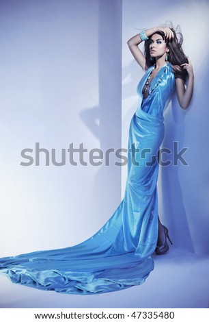 Stunning female beauty wearing blue dress - stock photo