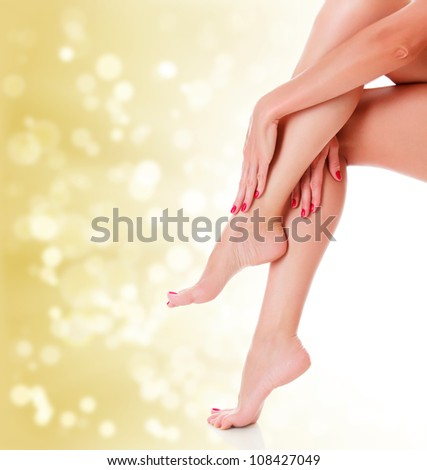 Stunning female legs on golden blurred background. - stock photo