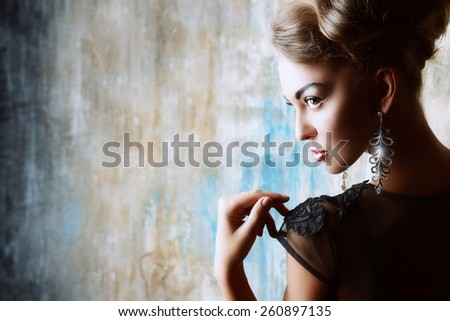 Stunning female model in black evening dress. Fashion shot. - stock photo