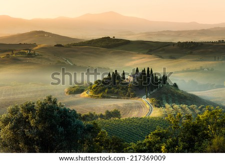 Stunning foggy morning on tuscany belvedere and hill panorama. - stock photo