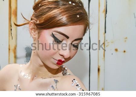 Stunning Girl With Doll Like Lips - stock photo