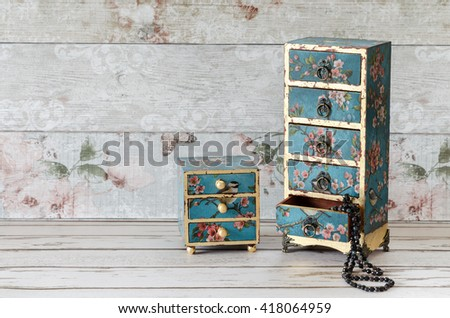 Stunning handmade jewellery boxes with decoupaged and gold leaf - stock photo