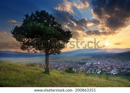stunning HDR sunset over the small valley with village in bulgarian Rodope mountain  - stock photo