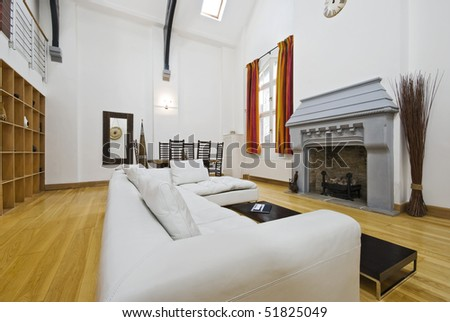 stunning historic building conversion with high ceiling and fireplace - stock photo