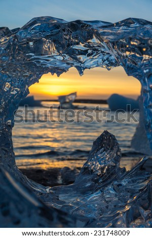 Stunning icy sunset with warm colors at Glacier lagoon, Iceland