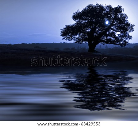Stunning image of landscape reflected in water with beautiful sky - stock photo