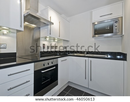 stunning kitchen with built in electric appliances