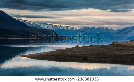 Stunning Lake Pukaki with Mount Cook Nationalpark in the background. Photo taken in New Zealand - stock photo