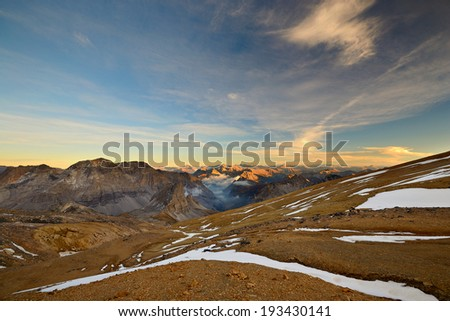 Stunning landscape at sunset from the summit of M. Thabor (3178 m) in the french Alps near the border to Italy. - stock photo