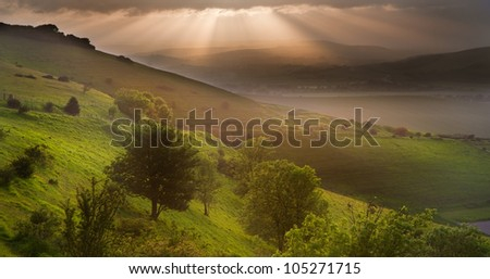 Stunning landscape at sunset over rolling English countryside - stock photo