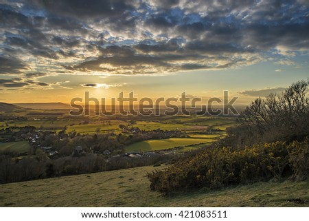 Stunning landscape image of sunset over countryside landscape in England - stock photo